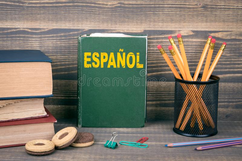 Learn spanish concept. Book on a wooden background royalty free stock photos