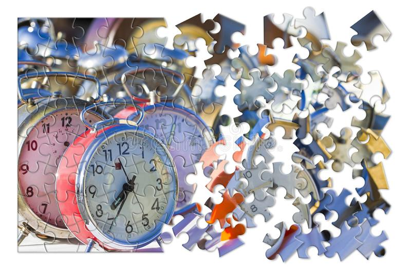 Learn to manage the time - Old colored metal table clocks, concept image in jigsaw puzzle shape royalty free stock images