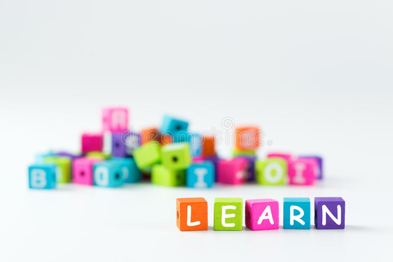 Learn word spelled with wooden blocks stock photos