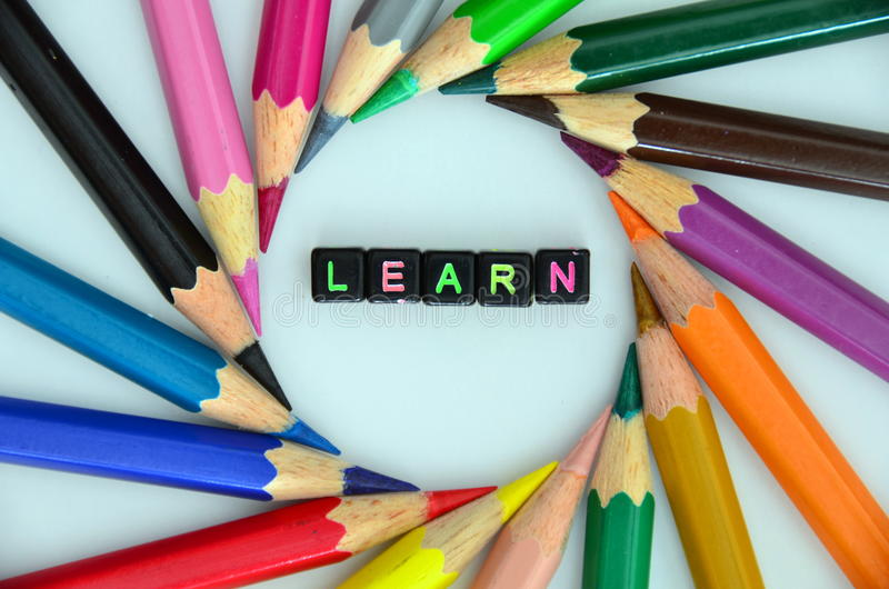LEARN word. Surrounded by color pencils stock images
