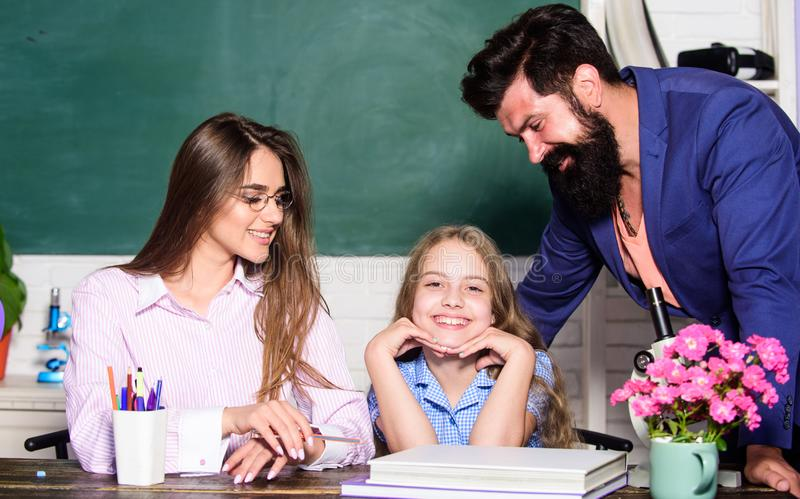 Learners must feel supported welcomed and respected. Mom and dad teachers helping child with learning. Smart family royalty free stock photography