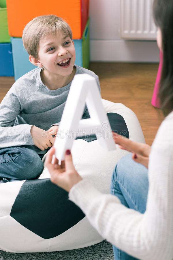 Learning can make child smile stock images