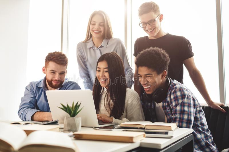 Learning concept. Diverse students preparing for exams in library royalty free stock photos