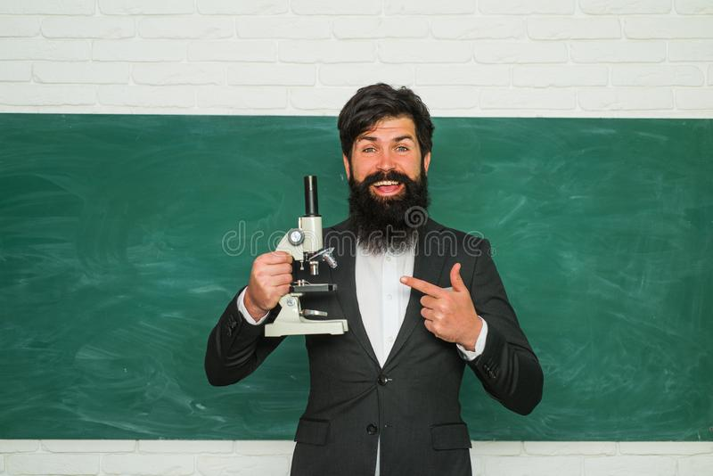 Learning and education concept. Preparing for exam in college. Portrait of male University Student indoors. Knowledge stock photo