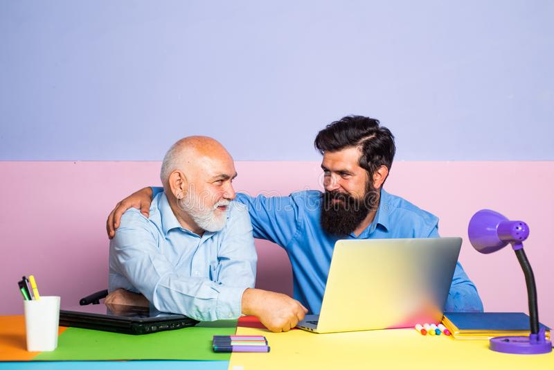 Learning and education concept. Teachers day. Teacher is skilled leader. Friendly bearded man with old mature teacher in. Classroom stock photos