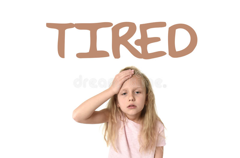 Learning English language vocabulary school card with the word tired and schoolgirl royalty free stock photography