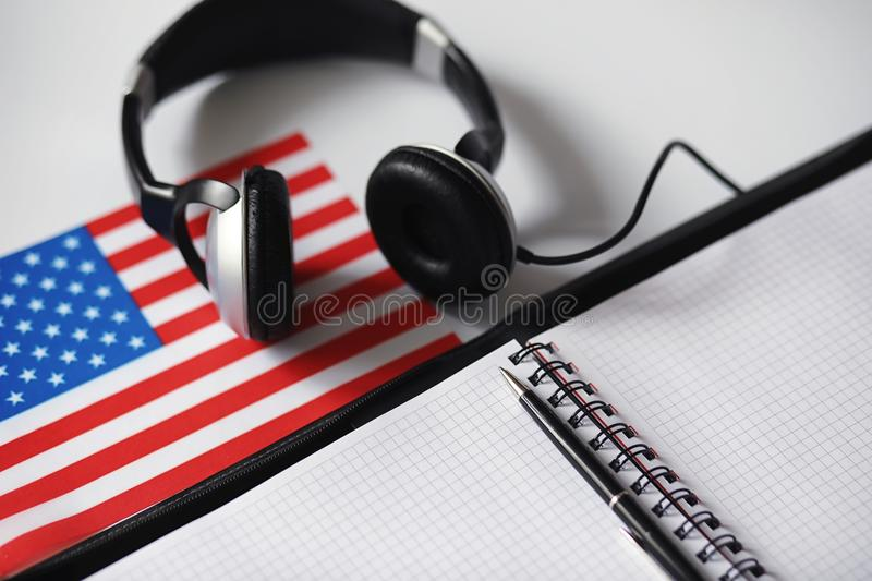 Learning foreign languages. Notepad for entries and a flag. Lang royalty free stock images
