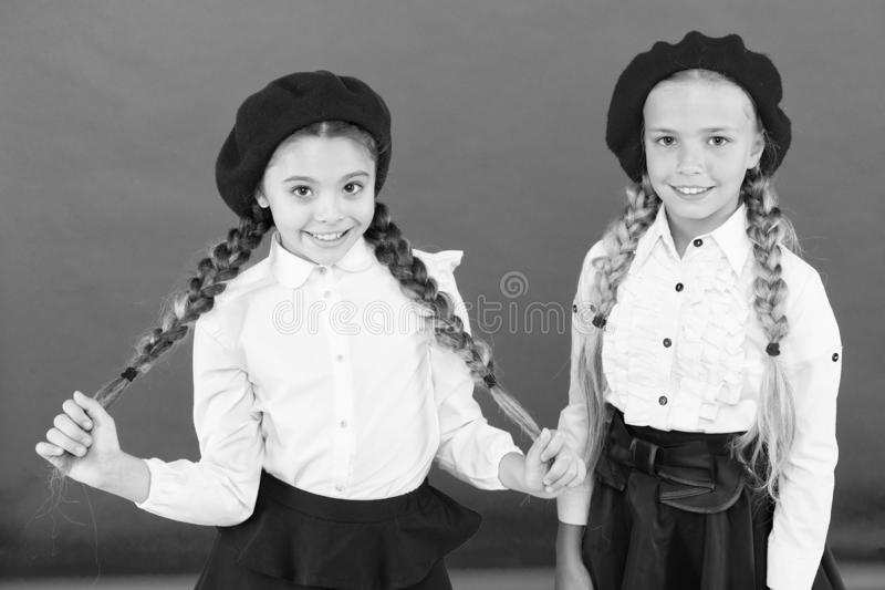 Learning french. happy children in uniform. friendship and sisterhood. best friends. little girls in french beret stock images