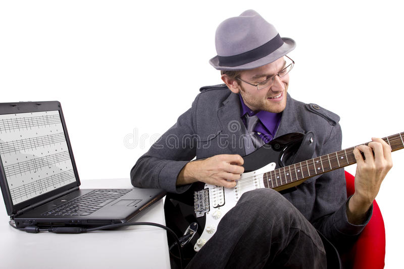 Learning Guitar Online Royalty Free Stock Images