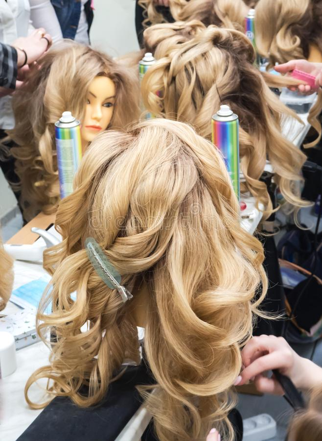 Learning hairstyles on the heads of mannequins. royalty free stock photo