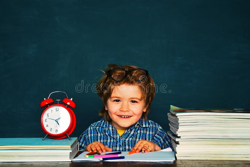 Learning at home. Kids gets ready for school. School or college pupil showing parents a test with good grade royalty free stock images