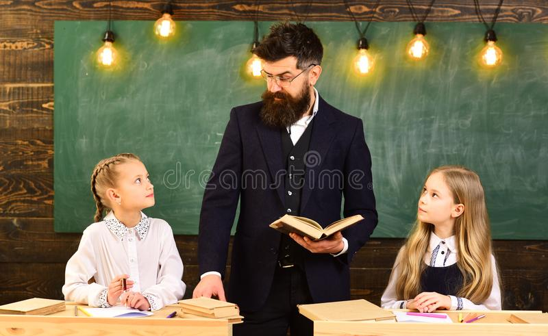 Learning at home. sisters learning literature at home. learning at home with serious teacher. learning at home concept. stock image