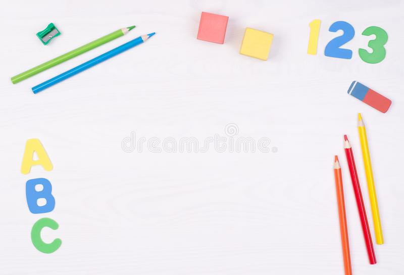 Learning how to read, write and count. Kid`s desk with colorful letters, numbers and pencils royalty free stock photo