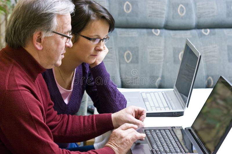 Learning how to use laptop stock photo