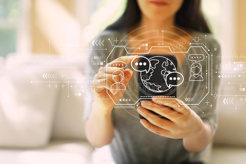 Learning Language concept with woman using a smartphone stock photo