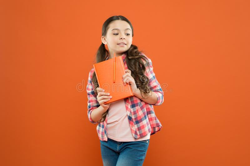 Learning language. Studying is exciting. Girl cute kid study with book. Interesting book. Did you know. Pupil with work. Book. Literature and writing lesson royalty free stock images