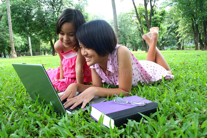 Learning in the park 3. Young girls learning in the park