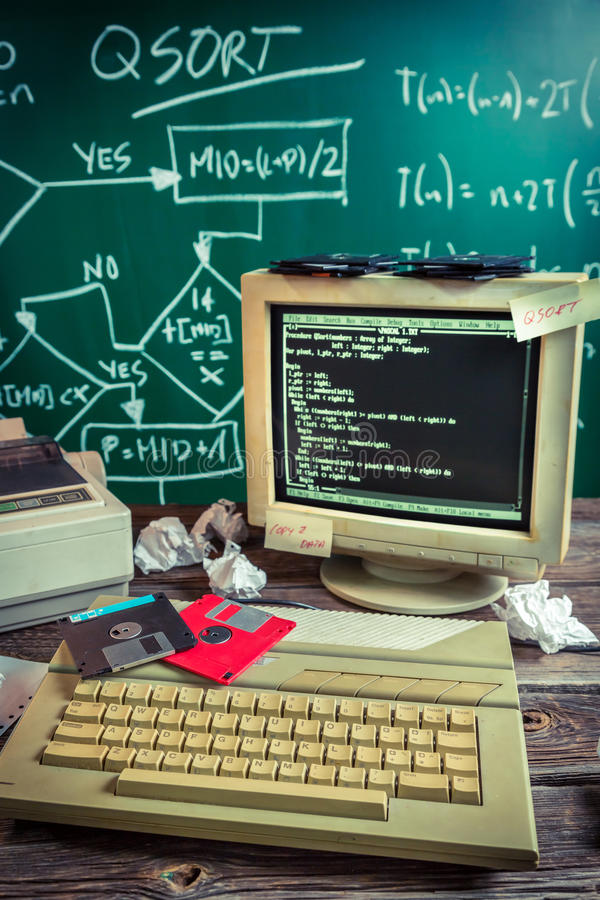 Learning a programming language at school. Retro style stock photo