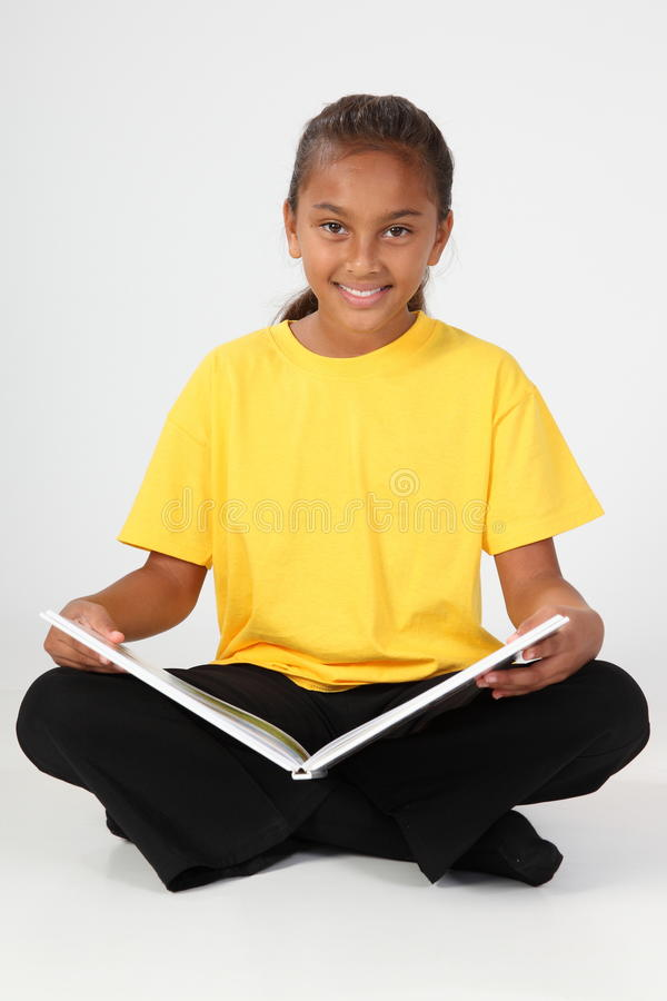 Learning by reading for young school girl 10 in ye