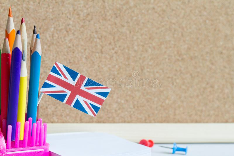 Learning speaking and teaching english with british flag abstract background concept royalty free stock images