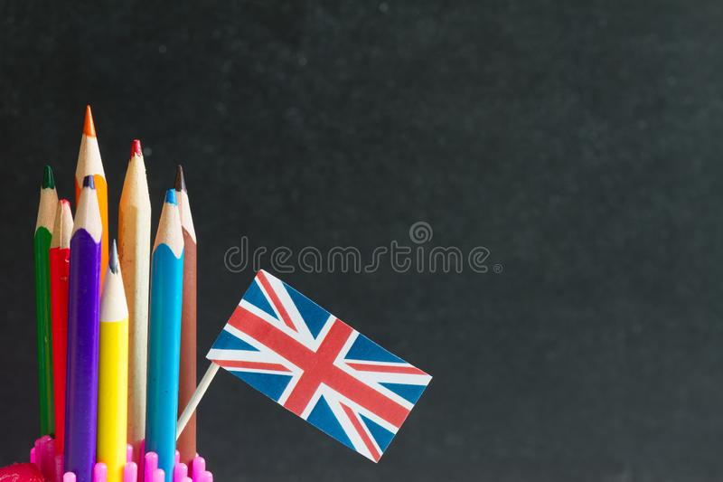 Learning speaking and teaching english with british flag abstract background concept royalty free stock photos