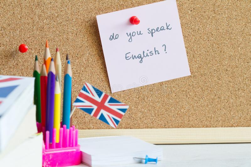 Learning speaking and teaching english with british flag abstract background concept stock image