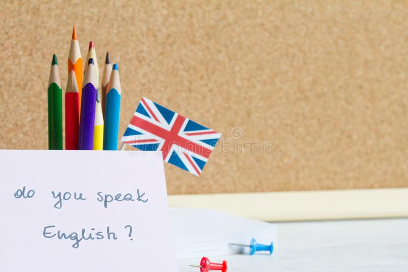 Learning speaking and teaching english with british flag abstract background concept stock photo