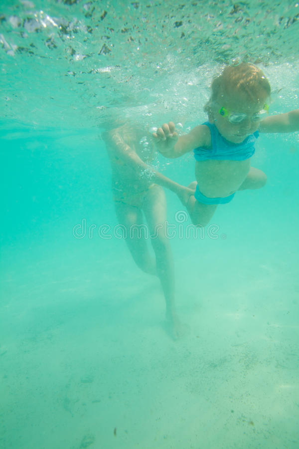Download Learning to dive stock image. Image of smile, holding - 21434417