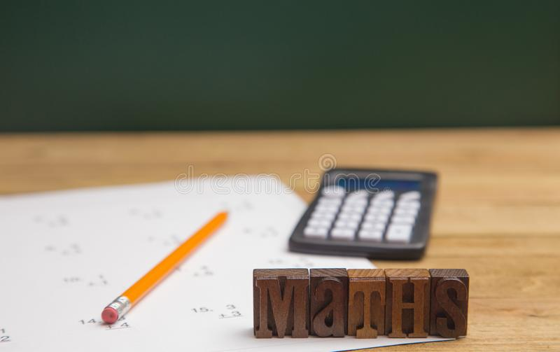 Learning to Do Maths. `Maths` Spelled Out with Simple Addition Worksheet stock image