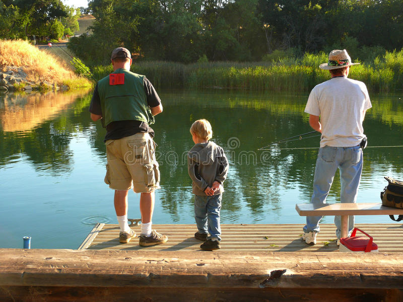 Learning To Fish From Dad And Uncle Joe Editorial Photo