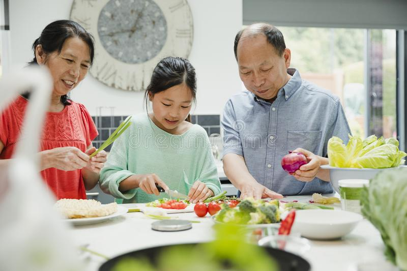 Learning to Make a Stir Fry with my Grandparents stock photos