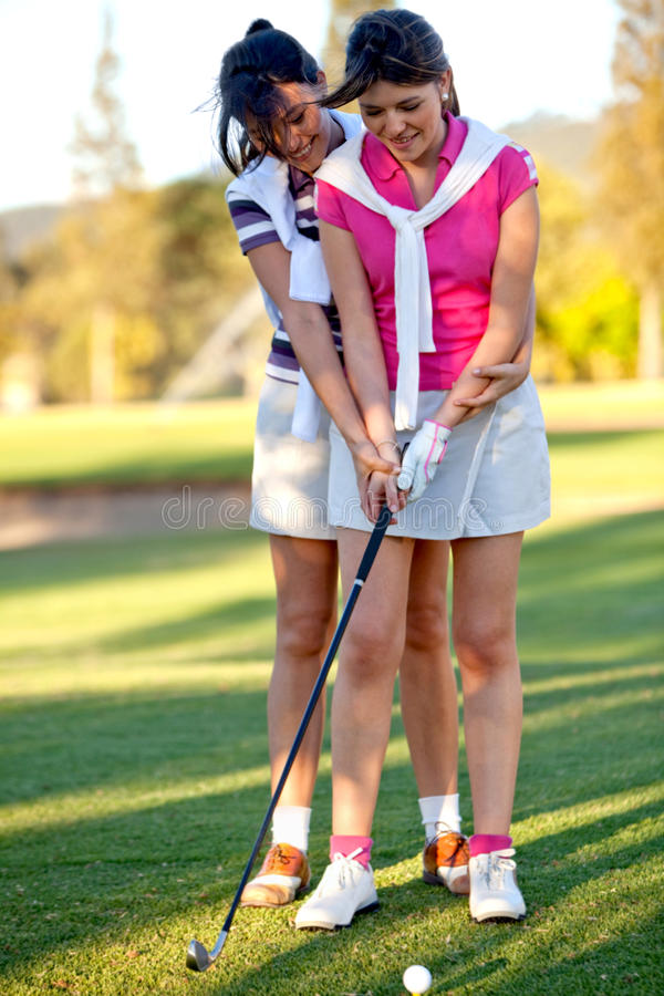 Download Learning to play golf stock photo. Image of females, sporty - 14175572