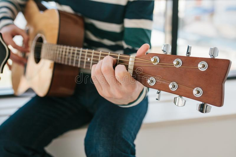 Learning to play the guitar. Music education and extracurricular lessons. Hobbies and enthusiasm for playing guitar and. Singing songs. To have fun stock photography