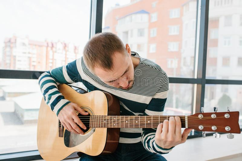 Learning to play the guitar. Music education. Learning to play the guitar. Music education and extracurricular lessons royalty free stock images