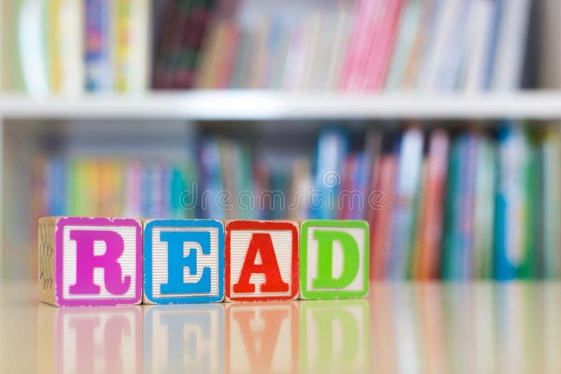 Learning to read concept. Children`s books and blocks royalty free stock image