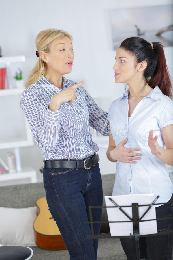 Learning to sing in choir together. Female royalty free stock photo