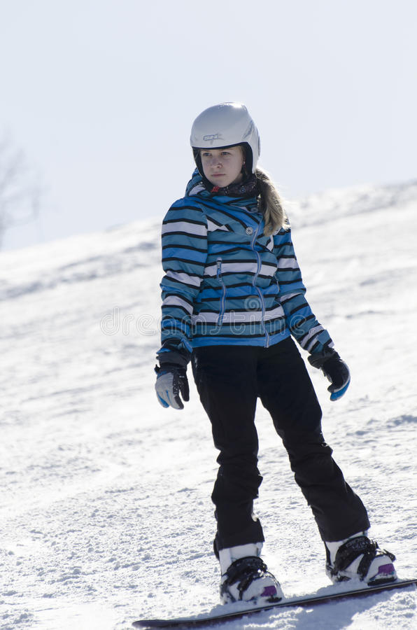 Learning to snowboard stock image
