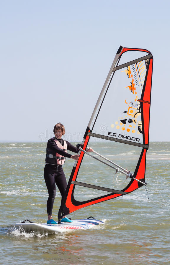 Learning to surf in surf school, on the Azov Sea in the city of Yeisk Krasnodar Territory, 14 September 2014. Learning to surf in surf school, on the Azov Sea in stock photos