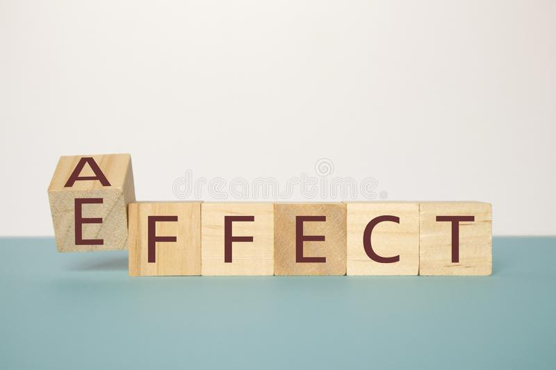 Learning to use proper grammar, Flipping one wooden cube to change the word Affect to Effect.  royalty free stock images