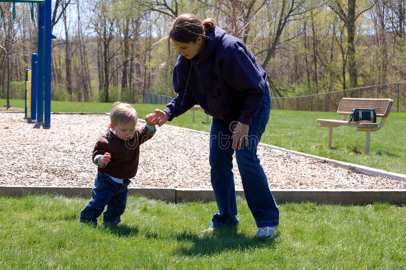 Download Learning to Walk stock image. Image of helping, walk, male - 1815885