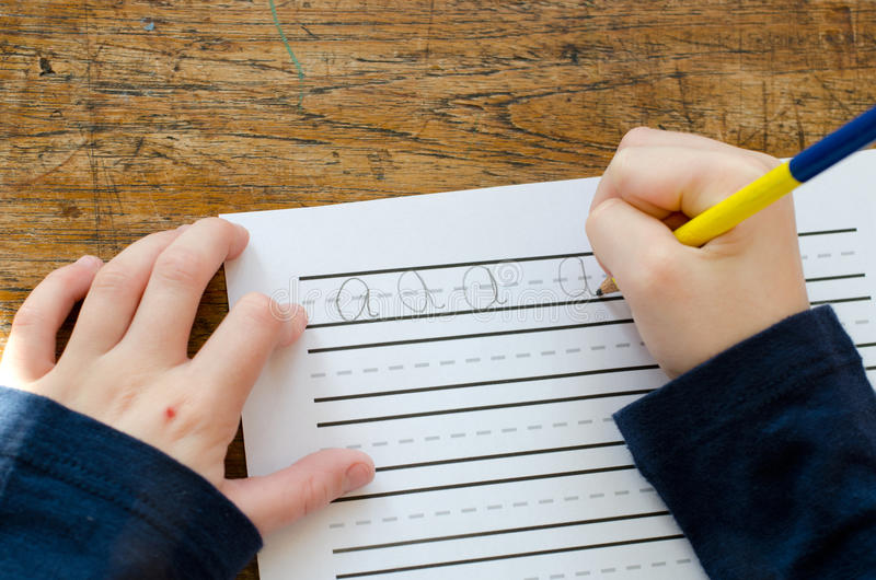 Learning to write abc stock photo