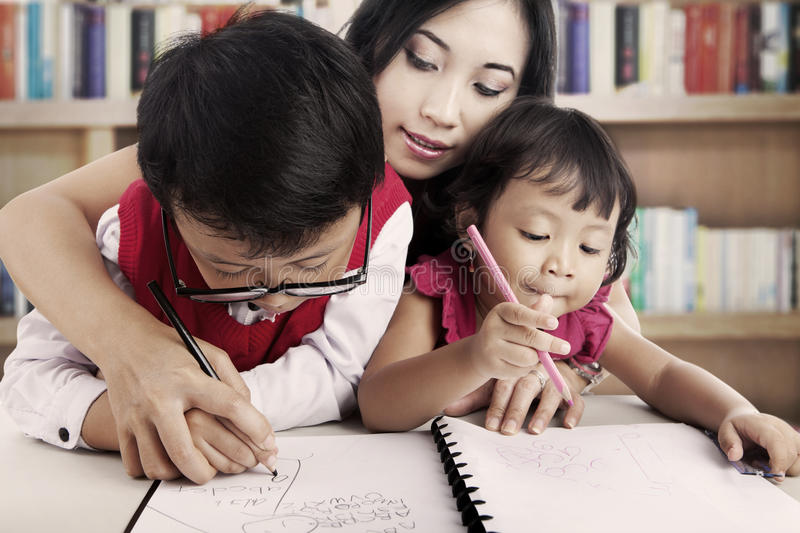 Download Learning to write together stock image. Image of children - 26657439