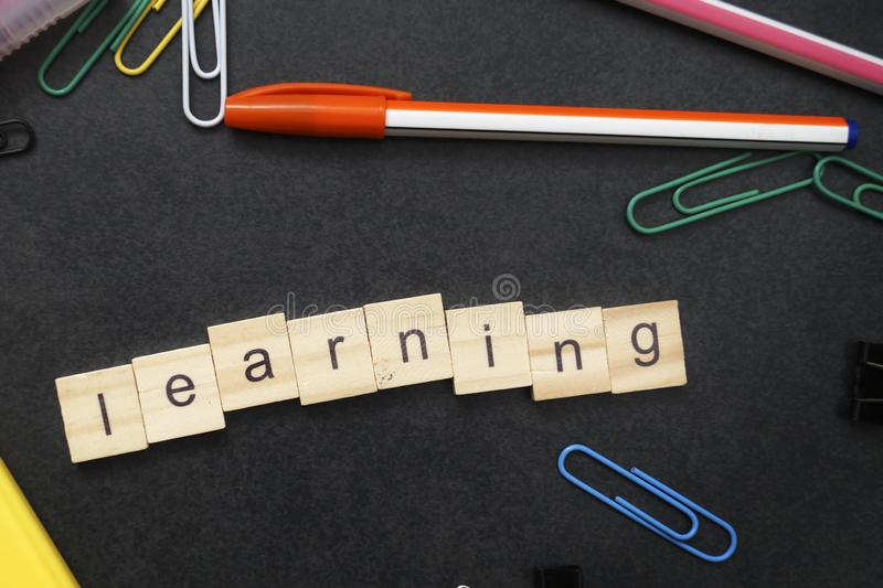 LEARNING word written on wood block. From above stock image