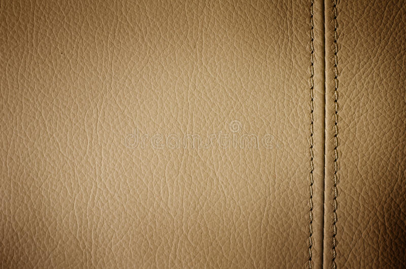 Leather. Brown pebbled leather with stitched seam