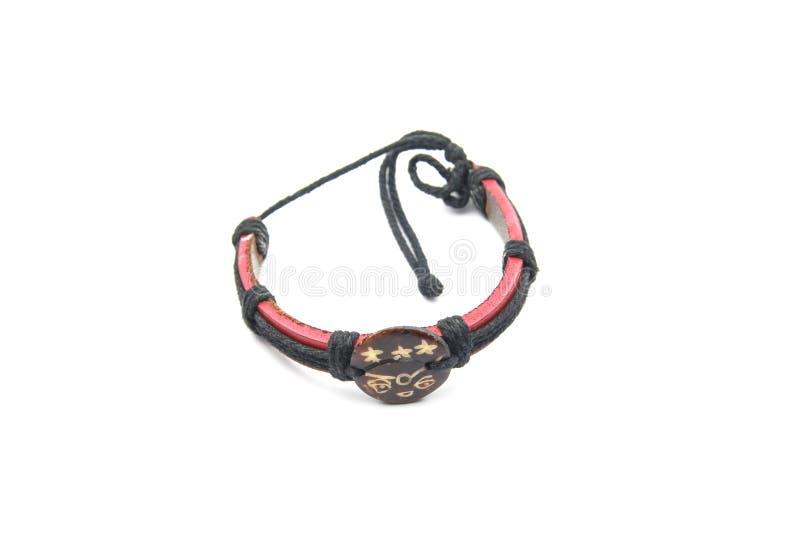 Leather arm bracelet. Isolated on white background royalty free stock photography