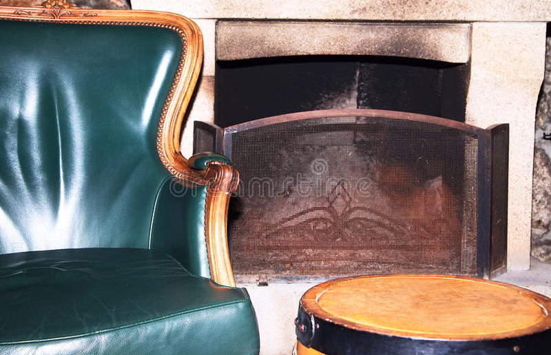 Download Leather Armchair In Retro Style Near The Fireplace Stock Image - Image: 83710381