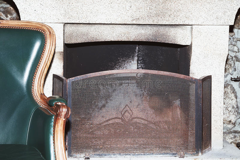 Download Leather Armchair In Retro Style Near The Fireplace Stock Photo - Image: 83711750