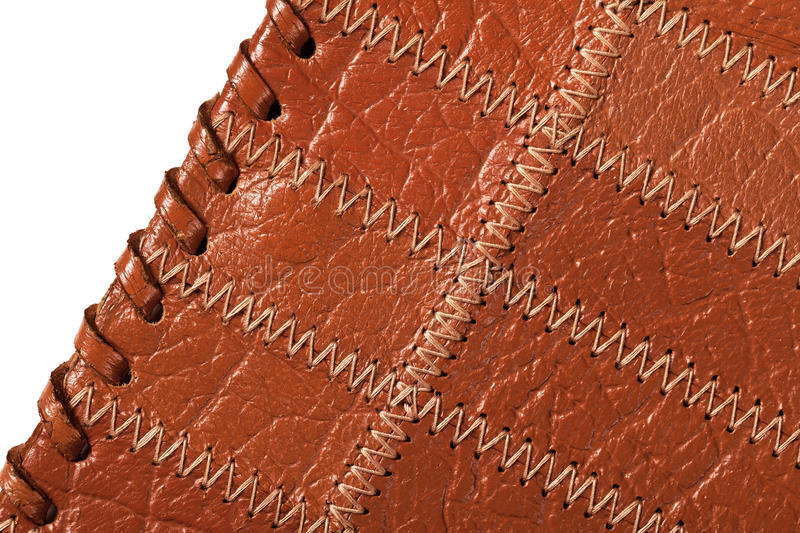 Leather Background. Brown leather texture isolated on white background . Macro shot royalty free stock images