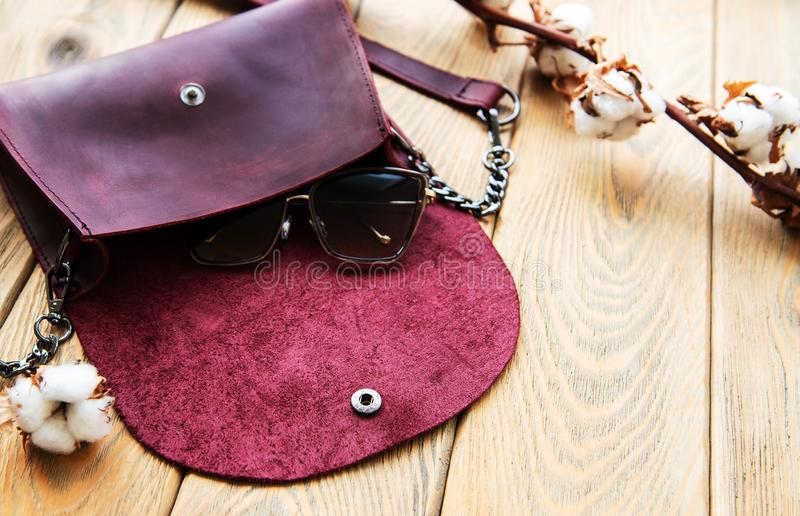 Leather bag and cotton flowers royalty free stock photos