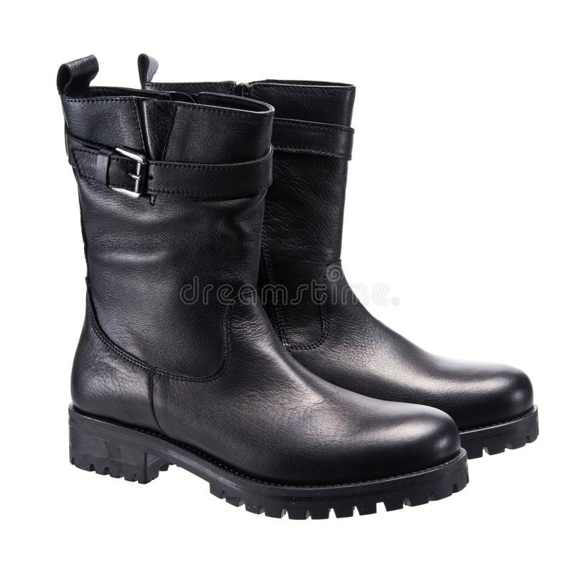 Leather black boots royalty free stock photography